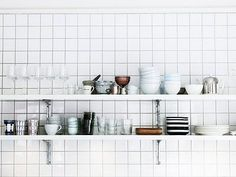white tile with white floating shelf with white bowls love