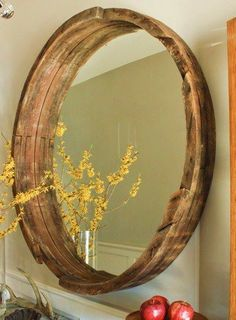 Repurposed whiskey barrel turned into a mirror frame. Great for entryways or even bathrooms!