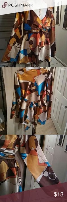 Cato Multicolor Blouse  FIRM Beautiful dress blouse that ties from under bust to back.  Long full sleeves.  Satin-like fabric. Gorgeous color combo. Burnt orange, tan, brown, gold, and Teal colors. Cato Tops Blouses