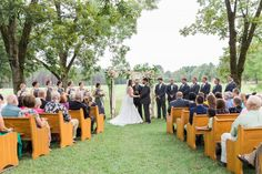 marion-ms-outdoor-wedding | ms outdoor wedding | church pews meridian ms | southern outdoor wedding | wedding arch with flowers | Ms wedding outdoors