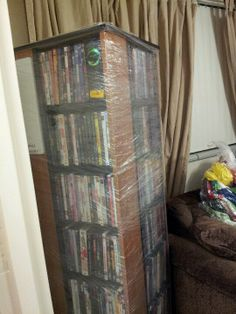 Packing tip. Moving tip. Use saran wrap to secure DVDs, books, etc. Eliminates the need to pack and re-shelve. However, be conscious of weight.