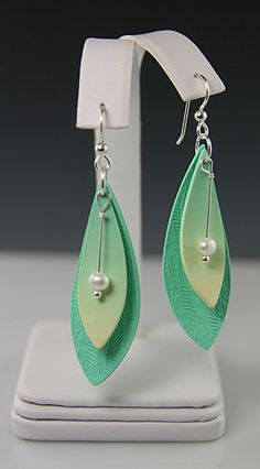 These earrings are longer and larger than my usual pieces.  Somehow, the double layers and the pearl dangles just seemed to need more space. I used Kato clay for these.
