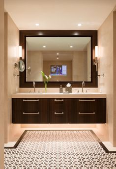 Warm glow of a bathroom vanity complete with integrated TV and underlighting…