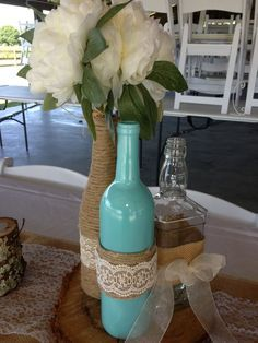 Tiffany Blue wine bottle decorations with twine and lace for a barn wedding. Wine Bottle Centerpieces, Rustic Wedding Centerpieces, Wedding Table, Diy Wedding, Wedding Decorations, Bottle Decorations, Wedding Rustic, Trendy Wedding, Wedding Ideas