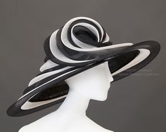 Giant black sinamay cartwheel hat lined in black Dupioni silk. c.2000. Peter Bettley. FRC2009.01.717