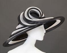 Giant black sinamay cartwheel hat lined in black Dupioni silk. c.2000. Peter Bettley. FRC2009.01.717