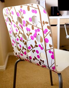Chair Decoupage: This chair was made with wrapping paper! We're loving the unique use of materials and how the pattern works with the holes already in the structure of the chair