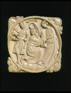 Mirror case depicting a lady crowning her lover, ivory, c. 1300-25, Paris, France.