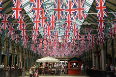 Flag buntings decorate Covent Garden market in London in readiness for the weekend celebrations to mark the Diamond Jubilee of Queen Elizabeth II, Wednesday, May 30, 2012. (AP / Sang Tan)