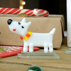 Fused Glass dog White Terrier Handmade glass dog figurine, the perfect addition to your collection or as a gift. Make your room stand out, with this picture perfect glass figurine. If you are looking for a one of a kind item to use in your home, this is it. This figurine will
