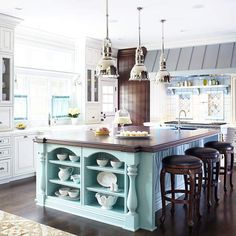 Soft robin's-egg blue is a welcoming hue in this traditional cottage kitchen. More colorful kitchen islands: http://www.bhg.com/kitchen/island/colorful-kitchen-islands/?socsrc=bhgpin041013robinseggblueisland=6