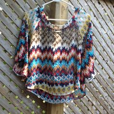 Geo/Aztec print sheer top Poncho/ batwing styled top. Sheer but not revealing. Front and back are identical. Flattering and shaping. Cropped but not. Comes to the waist line. Tops