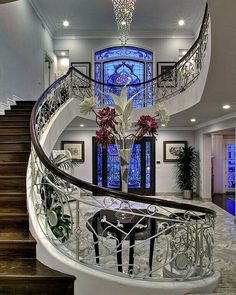 Amazing stairway, bannister and windows in this classy entryway