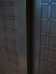 Lift door covered with VeroMetal Bronse, black patina
