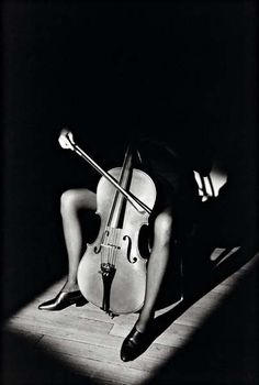 Photo by Jeanloup Sieff - Paris 1985 (Woman with Cello).