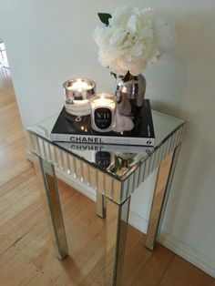 @BOMBARDIER DESIGNS  chanel book, mirrored table, scented candles #11