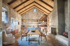 On a Croatian island in the Adriatic Sea, architect Antonio Zaninovic, designer Lucien Rees Roberts, and landscape architect David Kelly repurposed 15th-century ruins into a con...