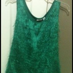 Fun Green Tank with Rows of Fringe and Shimmer NWOT**. Super cute green sleeveless blouse with rows of green fringe. Has shimmer mixed in with the fringe. Front is semi sheer but one can't see through due to the fringe. Back is a solid polyester blend and is not sheer. Never worn. Hand wash and line dry.  Made in Cambodia.  Shell 96% polyester, 4% spandex. Contrast 100% polyester. Cato Tops Tank Tops