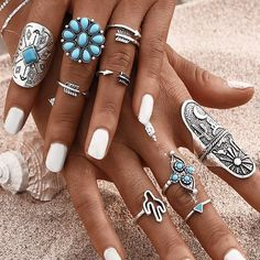 Be beautiful with Bohemian style. 9 ring set shown. Rings sizes vary (see image) and fit most fingers. Metal alloy is nickel free. Free shipping.