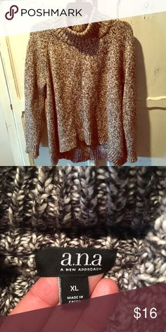 Brown and White Sweater Brown and white oversized sweater. High in the front and lower in the back. With a turtleneck style. Sweaters Cowl & Turtlenecks