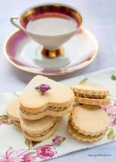 heart-shaped cookies and a beautiful cup of tea