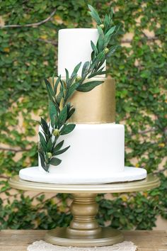 Wedding cake with touches of green and gold----I love this cake! This is the one. Simple and elegant.