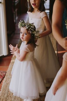 Flower girl with white dress and floral crown::