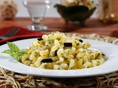 Even if the whole family isn't #glutenfree, everyone can enjoy this pasta recipe together: Barilla Gluten Free Elbows Pasta Salad with Basil Pesto, Eggplant & Parmigiano Cheese.