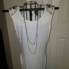 Dots tunic style white with beaded shoulders So cute! Tunic style cinched on the sides. Dots so cute!! Goes over butt, clasp in back very cute top. Size med!!! Never worn! Dots Tops Blouses