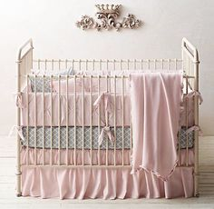 RH Baby & Child's Pintucked Bow & Trellis Print Nursery Bedding Collection:Pintucked seams crisscross our crib bumper, creating a texture-rich field of sweet bows to delight the eye and please the hand.