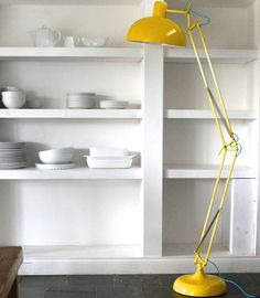 A fantastic floor standing angled lamp in a vibrant acid yellow finish.This adjustable floor lamp comes in a really gorgeous vibrant acid yellow and is great to have over your desk or beside a chair or sofa as a reading light. It has a good, sturdy base and so can also just be used as a free standing lamp to add a funky, contemporary feel to a room.Metal190x36x36cm