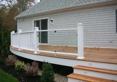 INTEX: Dartmouth Extruded Rail System shown with balusters and glass panel