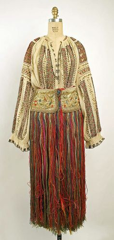 """European farm women's traditional dress (""""folk costume""""–worn even today in some regions) includes in many areas a type of garment awarded to a girl when she reached puberty: the so-called string skirt. Of no use for warmth or modesty, since it. Historical Costume, Historical Clothing, Costume Ethnique, Vintage Outfits, Vintage Fashion, Farm Women, Ethnic Dress, Antique Clothing, Folklore"""