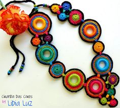 Colorful textile necklace with crochet rings from Lidia Luz Freeform Crochet, Crochet Art, Crochet Flowers, Crochet Patterns, Textile Jewelry, Fabric Jewelry, Jewellery, Crochet Bracelet, Crochet Earrings