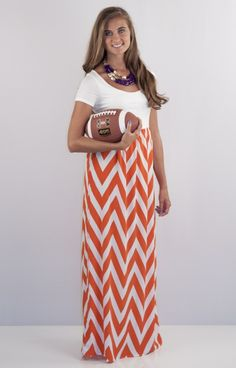 Clemson, Tennessee.... this dress is a blank canvas just for you! Throw on your favorite accessories and flatter your figure in this adorable orange and white chevron dress that is just fabulous for Game Day!