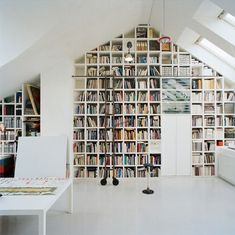Loft by Carouschka Streijffert // conversion of attic space into a loft in Stockholm If only I lived in a house that had a roof attic. All those booooks.