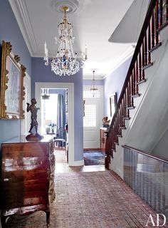 Instead of a hallway runner, roll out a large Persian rug!