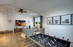 Farm-inspired gameroom with distressed hardwood floors; The Archer floor plan, Drees Custom Homes, Austin