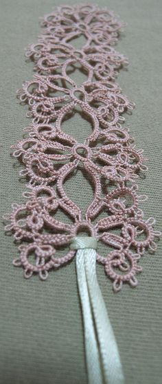 "Pattern is ""Black Magic"" from Mary Konior's ""Tatting with Visual Patterns."" ""Silkine"" size 50 crochet thread."