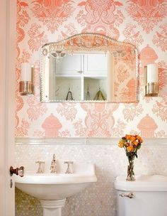 "1"" tiles that appear to be like wainscoting, pink/coral wallpaper, feminine bathroom with pedestal sink"