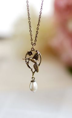 Hummingbird Necklace. Antique Brass Hummingbird with Vintage Teardrop Cream White Glass Pearl Necklace.  A beautiful vintage style charm that features a