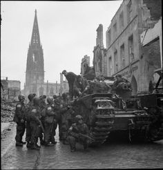 BRITISH ARMY NORTH-WEST EUROPE 1944-45 (BU 2931)   A Churchill tank crew and US Airborne troops in Munster, 4 April 1945.