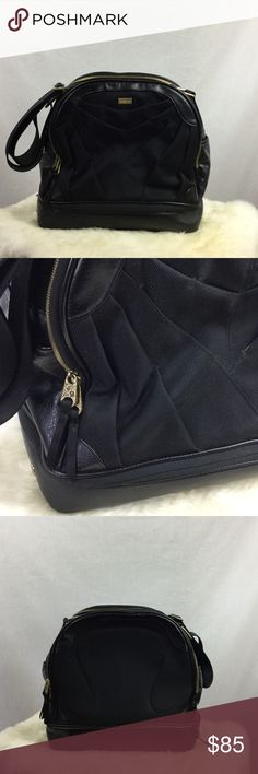 """Lululemon Activa Bowling Bag Bottom unzips for shoe storage.  Some dust from storing.  One small nick and tiny wear on trim as seen in photos. Makeup area inside has pen stain. Tons of storage!  Some scuffs on bottom. Inside is very clean.  Adjustable thick 2"""" strap. Approx 14"""" wide, 14"""" high, and 8"""" deep. lululemon athletica Bags"""