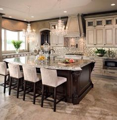 Love the size of this island but not necessarily the ornate details on it. Kitchen is otherwise beautiful.