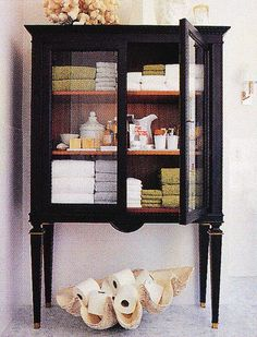 re-purposed cabinet for bath storage I have an old piece of furniture that could be used for this. Hmm........