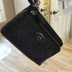 """Authentic Coach Wristlet Used, but in perfect condition. Authentic Coach wristlet with signature """"C"""". Two separate compartments, the bigger one has credit card slots in it. Coach Bags Clutches & Wristlets"""