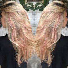 Pastel pink highlights in blonde hair