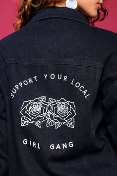 """An edgy juniors denim jacket perfect for creating a daring OOTD! Includes button-ups, front pockets, frayed hemlines, and a graphic embellishment featuring roses and the phrase """"support your local girl gang."""" Matches well with distressed skinny jeans and studded high-heel boots."""