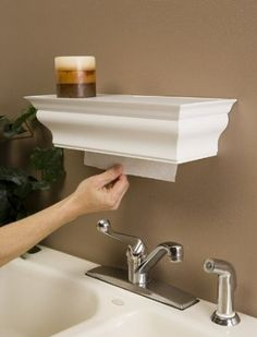 This is a single sheet folded paper towel dispenser with a shelf for sale, but I bet you could replicate it as a DIY project with some crown molding and such and make it for a paper towel roll instead, if desired. Or a tissue box in the bathroom...