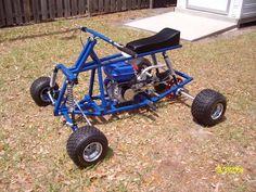 Grasshopper Gas powered 4 Wheeler. Independent 4 wheel suspension. Trick & Sweet